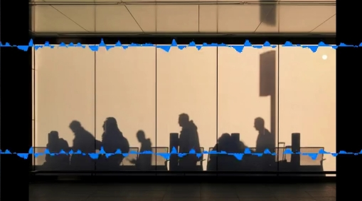Sound waves over a picture of silhouettes of people walking past a window in heathrow airport