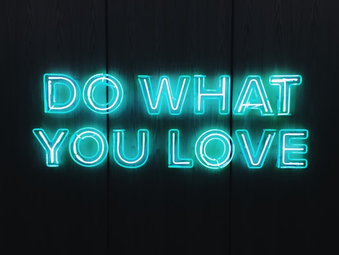 "Neon sign saying ""Do what you love"""